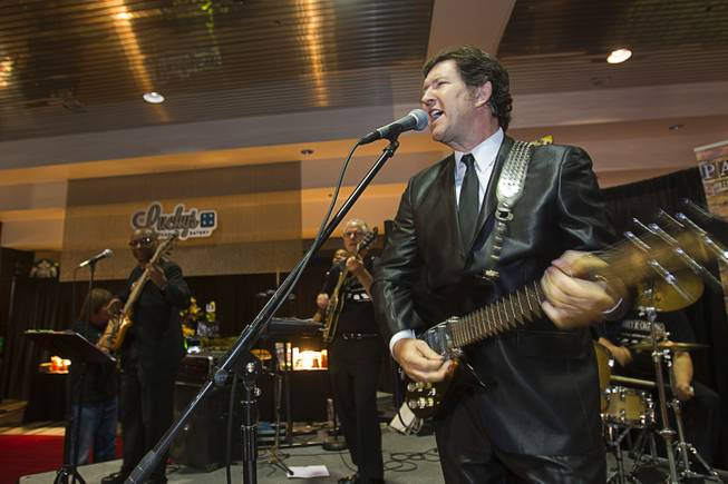 Paul Casey and the Abbey Road Crossing band perform during a news conference in the lobby of the Las Vegas Convention Center Tuesday, Aug. 12, 2014. The event celebrated the 50th anniversary of the Beatles concert in Las Vegas on August 20, 1964. A multi-media exhibition commemorating the event will be on display in the lobby of the LVCC through Oct. 27.
