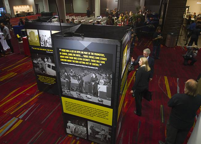 A multi-media exhibition commemorating the 1964 Beatles concert in Las Vegas is displayed during a news conference in the lobby of the Las Vegas Convention Center Tuesday, Aug. 12, 2014. The exhibition will be on display in the lobby of the LVCC through Oct. 27.