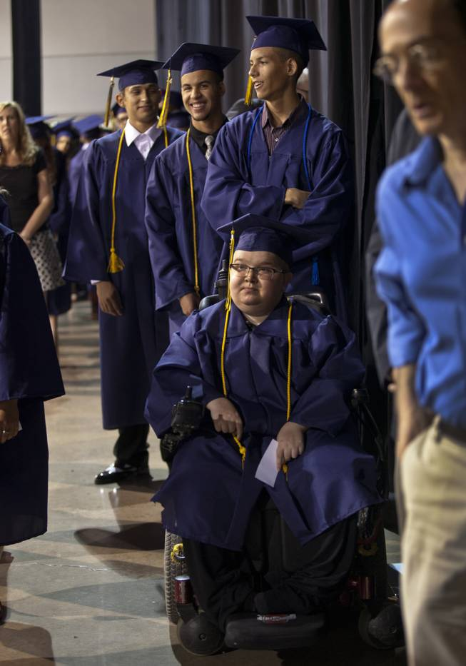 Lifelong friends Colton Shrum, Darius Martin and D'Aron Martin line up with other students at the Cashman Center  for their Odyssey Charter School graduation on Tuesday, June, 3, 2014.  L.E. Baskow