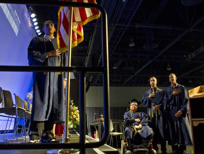 Colton Shrum, D'Aron Martin and Darius Martin recite the Pledge of Allegience with other students at the Cashman Center  for their Odyssey Charter School graduation on Tuesday, June, 3, 2014.  L.E. Baskow