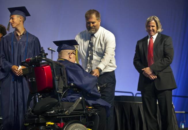 Colton Shrum receives his diploma during the Cashman Center  for their Odyssey Charter School graduation on Tuesday, June, 3, 2014.  L.E. Baskow