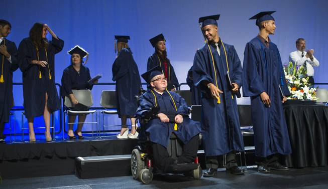 Lifelong friends Darius Martin, Colton Shrum and D'Aron Martin are all smiles during the Odyssey Charter School graduation at the Cashman Center on Tuesday, June, 3, 2014.  L.E. Baskow