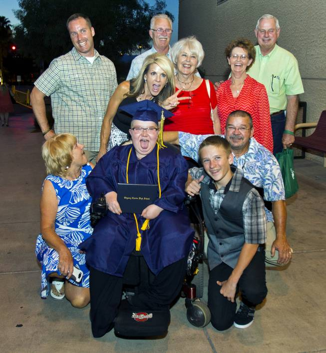 Colton Shrum and his family members share a fun moment following his Odyssey Charter School graduation at the Cashman Center on Tuesday, June, 3, 2014.  L.E. Baskow