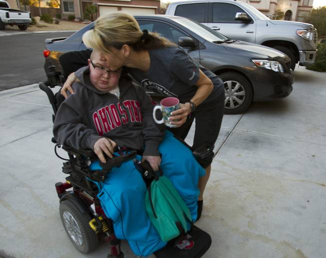 Colton Shrum is hugged by his mother Shelly Shrum before leaving for class at Odyssey Charter School on Tuesday, January, 28, 2014.  L.E. Baskow