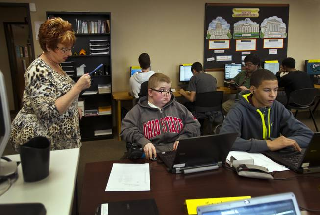 An Odyssey Charter School teacher instructs as friends Colton Shrum and Darius Martin attend class Tuesday, Jan. 28, 2014.