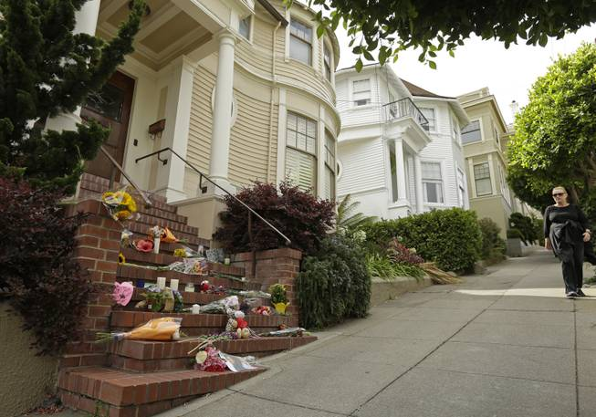 "Mementos are left on the steps of a residence Tuesday, Aug. 12, 2014, in San Francisco, which was used in the film of ""Mrs. Doubtfire,"" starring Robin Williams. Sheriff's officials say Williams committed suicide by hanging himself at his home in Tiburon, outside San Francisco."