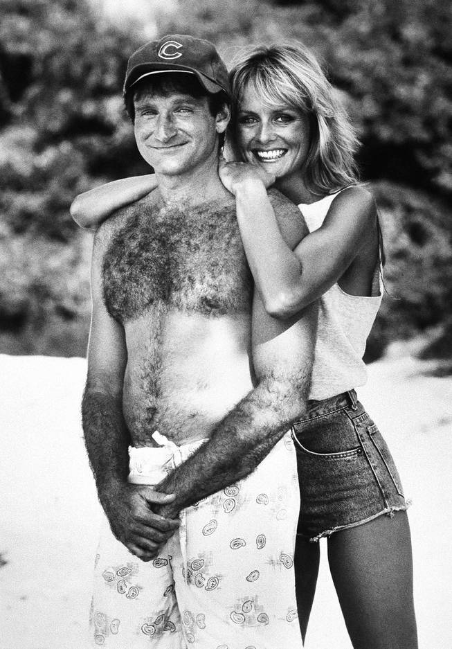 Actor Robin Williams, left, in character as ex-Chicago fireman Jack Moniker poses with actress and model Twiggy, also in character for the comedy Club Paradise, 1986.
