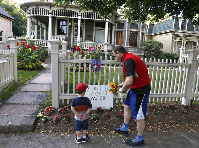 "U.S. Rep. Jared Polis, D-Colo., and his son AJ leave flowers at the home where the 80's TV series ""Mork & Mindy"", starring the late Robin Williams, was set, in Boulder, Colo., Monday Aug. 11, 2014. Robin Williams, the Academy Award winner and comic supernova whose explosions of pop culture riffs and impressions dazzled audiences for decades and made him a gleamy-eyed laureate for the Information Age, died Monday in an apparent suicide. He was 63."
