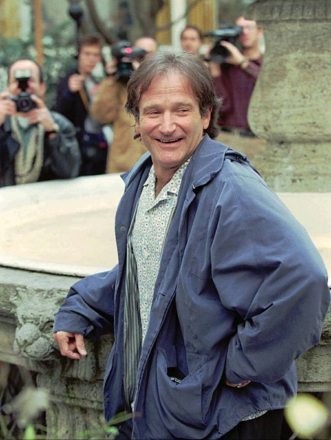 "Actor-comedian Robin Williams poses for the photographers in the backyard of a hotel in Hamburg, Germany, on Friday, April 19, 1996. Williams, well known for his movies ""Mrs. Doubtfire"", ""Hook"", ""Dead Poets Society"",  ""Good Morning Vietnam"" and more recently ""Jumanji"", is promoting  his new picture ""Birdcage."""