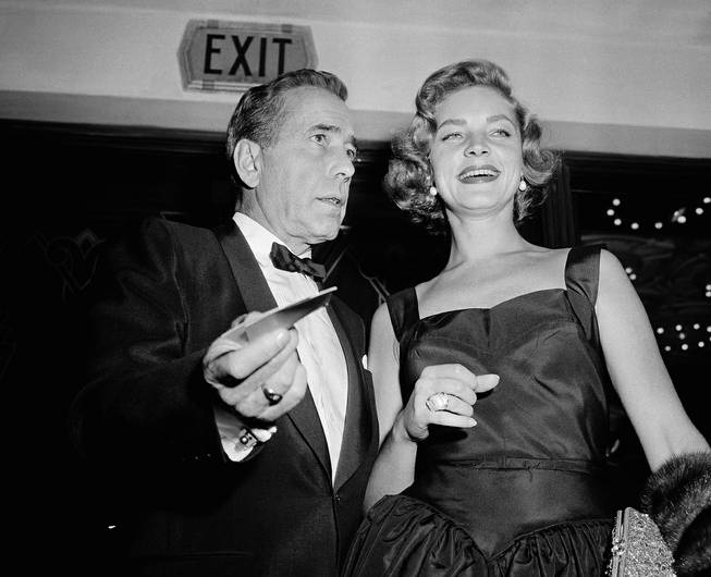 "Humphrey Bogart, one of the stars of ""The Desperate Hour,"" arrives with his wife, Lauren Bacall, for the Hollywood premiere of the picture, Oct. 12, 1955."
