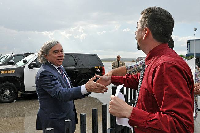 Energy Secretary Ernest Moniz is welcomed at the Carlsbad, N.M., airport as he arrives in southeastern New Mexico Monday, Aug. 11, 2014, to visit the government's troubled nuclear waste dump and talk with residents about the mysterious radiation leak and truck fire that have shuttered the Waste Isolation Pilot Plant indefinitely. About a dozen community leaders and residents were at the Carlsbad airport to welcome Moniz and show their continued support for the plant, which is the federal government's only permanent repository for waste from decades of nuclear bomb building and employs about 650 people.
