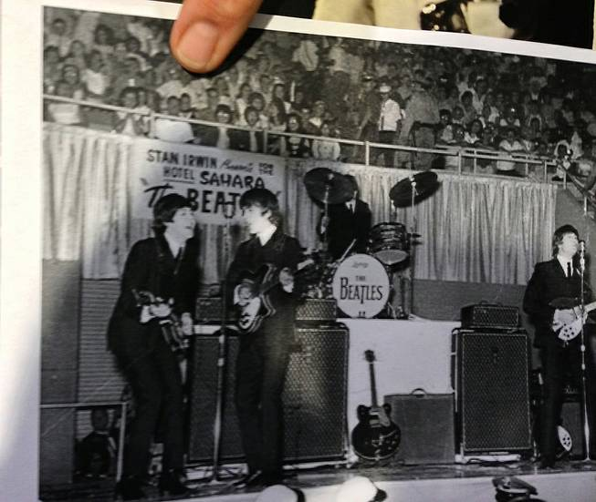 Stuart Pitz places his thumb over his head in this shot from the Beatles' Aug. 20, 1964, appearance at the Las Vegas Convention Center. Pitz attended the show with his sister and was also on hand at the 50th anniversary celebration of the Beatles' visit to Las Vegas at the Convention Center on Tuesday, Aug. 12, 2014.