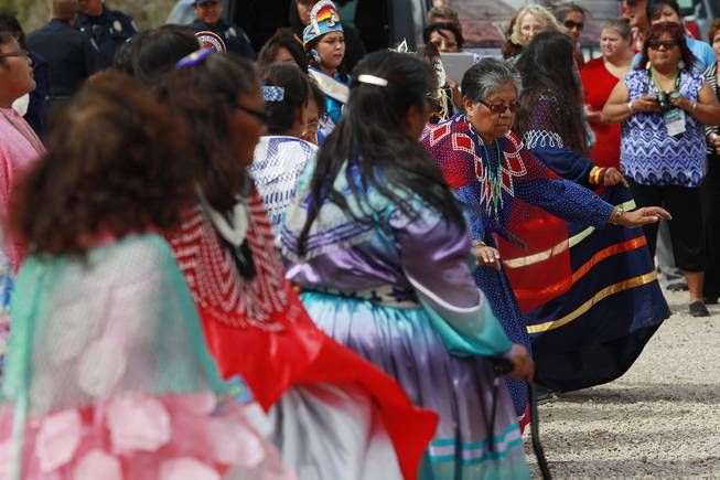 Hualapai Bird Dancers perform a road blessing dance during the official opening of the newly paved section of Diamond Bar Road leading to Grand Canyon West Tuesday, Tuesday, Aug. 12, 2014.