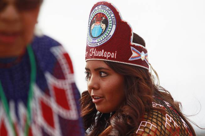 Miss Hualapai Elena Bravo performs a road blessing dance with the Hualapai Bird Dancers during the official opening of the newly paved section of Diamond Bar Road leading to Grand Canyon West Tuesday, Tuesday, Aug. 12, 2014.