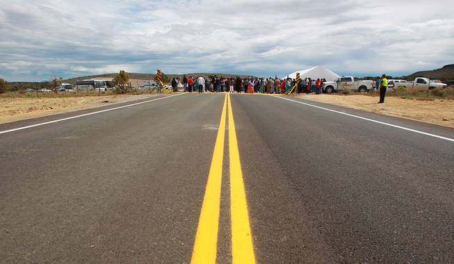 Hualapai tribe members and guests take part in the official opening of the newly paved section of Diamond Bar Road leading to Grand Canyon West Tuesday, Tuesday, Aug. 12, 2014.