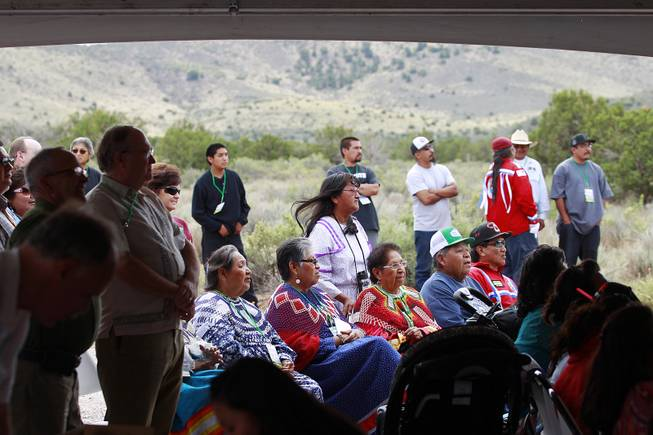 Hualapai tribe members and guests gather for the official opening of the newly paved section of Diamond Bar Road leading to Grand Canyon West Tuesday, Tuesday, Aug. 12, 2014.