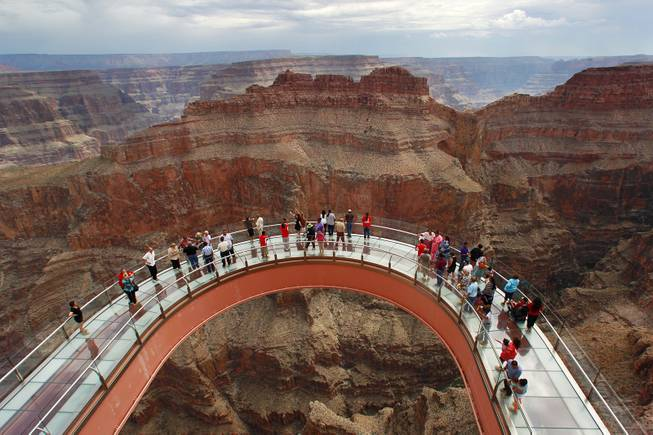 Hualapai tribe members and guests tour the Skywalk after the official opening of the newly paved section of Diamond Bar Road leading to Grand Canyon West Tuesday, Tuesday, Aug. 12, 2014.