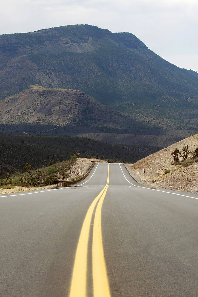 A section of the newly paved section of Diamond Bar Road heads away from Grand Canyon West Tuesday, Tuesday, Aug. 12, 2014.