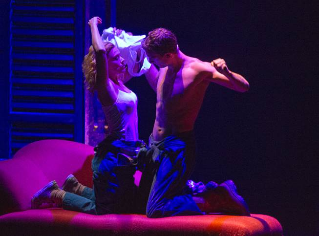 "Molly (Katie Postotnik) and Sam (Steven Grant Douglas) get comfortable in their new apartment during ""Ghost The Musical"" at the Smith Center for the Performing Arts on Wednesday, Aug. 13, 2014, in downtown Las Vegas."