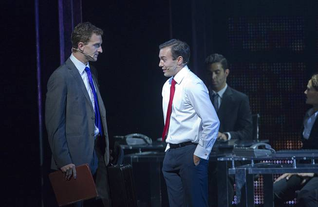 "Sam (Steven Grant Douglas) talks with his friend Carl (Robby Haltiwanger) in the office during ""Ghost The Musical"" at the Smith Center for the Performing Arts on Wednesday, Aug. 13, 2014, in downtown Las Vegas."