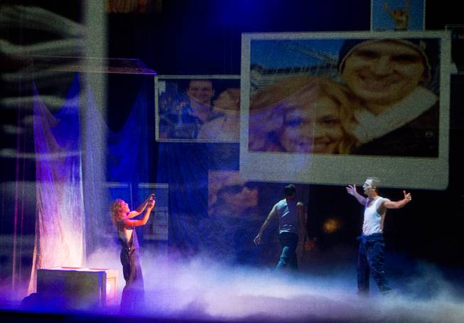 "Molly (Katie Postotnik) takes a photo of Sam (Steven Grant Douglas) in their new apartment during ""Ghost The Musical"" at the Smith Center for the Performing Arts on Wednesday, Aug. 13, 2014, in downtown Las Vegas."