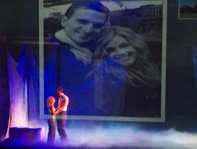 "Molly (Katie Postotnik) and Sam (Steven Grant Douglas) embrace in their new apartment during ""Ghost The Musical"" at the Smith Center for the Performing Arts on Wednesday, Aug. 13, 2014, in downtown Las Vegas."