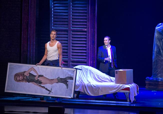 "Sam (Steven Grant Douglas) brings a Barbarella poster into the apartment as friend Carl (Robby Haltiwanger) watches during ""Ghost The Musical"" at the Smith Center for the Performing Arts on Wednesday, Aug. 13, 2014, in downtown Las Vegas."