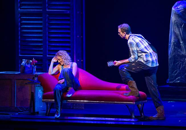 "Molly (Katie Postotnik) is serenaded by Sam (Steven Grant Douglas) in their new apartment during ""Ghost The Musical"" at the Smith Center for the Performing Arts on Wednesday, Aug. 13, 2014, in downtown Las Vegas."