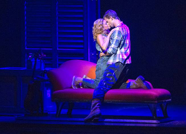 "Molly (Katie Postotnik) and Sam (Steven Grant Douglas) kiss in their new apartment during ""Ghost The Musical"" at the Smith Center for the Performing Arts on Wednesday, Aug. 13, 2014, in downtown Las Vegas."