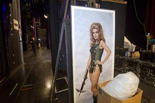 A Barbarella (a 1968 film starring Jane Fonda) movie poster, a prop in one of the scenes, is shown during a backstage tour of