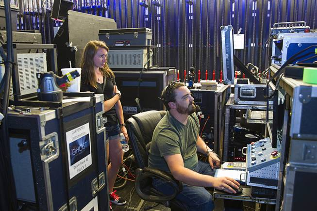 "Head carpenter Matt Cowles prepares for the company's 299th performance during a backstage tour of ""Ghost The Musical"" at the Smith Center for the Performing Arts Wednesday Aug. 13, 2014. Elizabeth Aresti looks on at left. The musical runs through Sunday, Aug. 17."