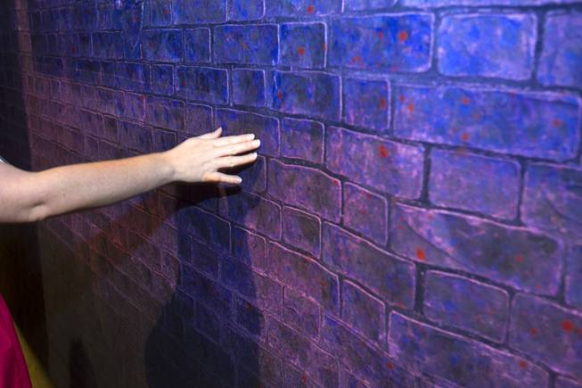 "A ""brick"" wall is shown during a backstage tour of ""Ghost The Musical"" at the Smith Center for the Performing Arts Wednesday Aug. 13, 2014. The wall looks like brick from the audience but is actually made from a rubber roofing material. The musical runs through Sunday, Aug. 17."