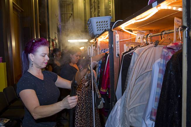 "Nathaly Big Mountain steams clothes in a wardrobe department during a backstage tour of ""Ghost The Musical"" at the Smith Center for the Performing Arts Wednesday Aug. 13, 2014. The musical runs through Sunday, Aug. 17."