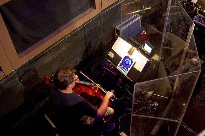 "A musician warms up in the orchestra pit during a backstage tour of ""Ghost The Musical"" at the Smith Center for the Performing Arts Wednesday Aug. 13, 2014. The musical runs through Sunday, Aug. 17."