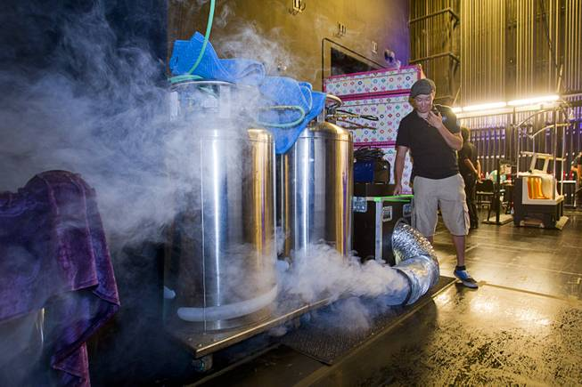 "Brandi Fucci tests a fog machine during a backstage tour of ""Ghost The Musical"" at the Smith Center for the Performing Arts Wednesday Aug. 13, 2014. The production uses four foggers and four hazers. The musical runs through Sunday, Aug. 17."