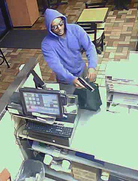 Metro Police are seeking this man in the robbery of a business near Rainbow and Charleston boulevards on July, 22, 2014.