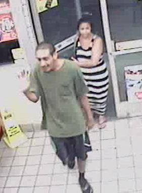 Metro Police identified this man and woman as suspects in the robbery of a motorist near Harmon Avenue and Spencer Street on Aug. 5, 2014.