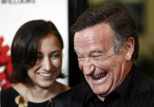 "Cast member Robin Williams, right, and his daughter, Zelda, pose together at the premiere of ""World's Greatest Dad"" in Los Angeles on Thursday, Aug. 13, 2009."