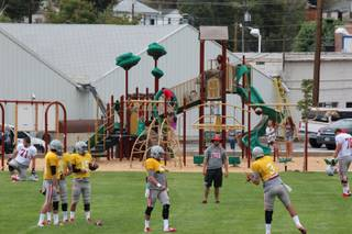 We practice at a public park here in Ely (Broadbent Park) so this is a shot of a quarterback drill in front of the kids using the playground set.