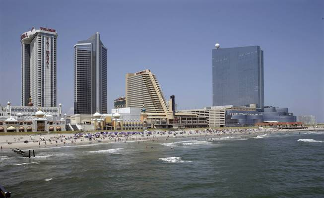 This Wednesday, July 23, 2014, photo shows casinos along the Atlantic City, N.J. boardwalk, from left, the Trump Taj Mahal Casino, with its Chairman Tower, the Showboat Casino Hotel and the Revel Casino Hotel.