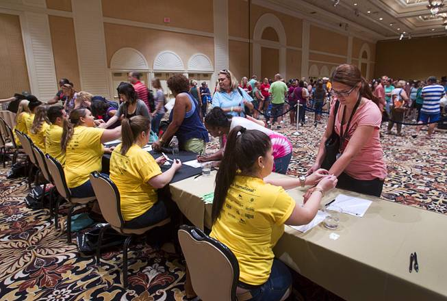 Teachers sign in to pick up free school supplies during MGM Resorts annual Educator Appreciation Day at the Mirage Thursday Aug. 14, 2014. In addition to school supplies provided by MGM Resort employees, a variety of agencies participated in the days activities to introduce educators to teaching resources available in the community.