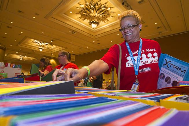 Bernava Johnson-Gafeney, a school psychologist, picks up free school supplies during MGM Resorts annual Educator Appreciation Day at the Mirage Thursday Aug. 14, 2014. In addition to school supplies provided by MGM Resort employees, a variety of agencies participated in the days activities to introduce educators to teaching resources available in the community.