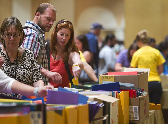 Teachers look over free school supplies during MGM Resorts annual Educator Appreciation Day at the Mirage Thursday Aug. 14, 2014. In addition to school supplies provided by MGM Resort employees, a variety of agencies participated in the days activities to introduce educators to teaching resources available in the community.