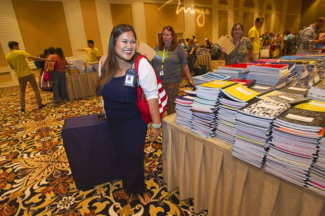 Jennifer Yupangco, a kindergarten teacher at Dearing Elementary School, uses a rolling suitcase to carry free school supplies during MGM Resorts annual Educator Appreciation Day at the Mirage Thursday Aug. 14, 2014. In addition to school supplies provided by MGM Resort employees, a variety of agencies participated in the days activities to introduce educators to teaching resources available in the community.