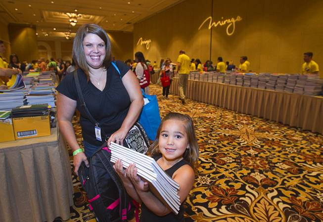 Jovanna Chavez, 6, helps her mother Chrystina Skerstonas with school supplies during MGM Resorts annual Educator Appreciation Day at the Mirage Thursday Aug. 14, 2014. Skerstonas is a special education teacher at Brookman Elementary School. In addition to school supplies provided by MGM Resort employees, a variety of agencies participated in the days activities to introduce educators to teaching resources available in the community.