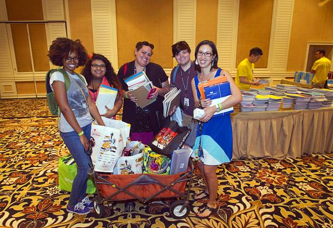 Ebonee Coe, left, and other Park Elementary School teachers, pose with a wagon load of school supplies during MGM Resorts annual Educator Appreciation Day at the Mirage Thursday Aug. 14, 2014. In addition to school supplies provided by MGM Resort employees, a variety of agencies participated in the days activities to introduce educators to teaching resources available in the community.