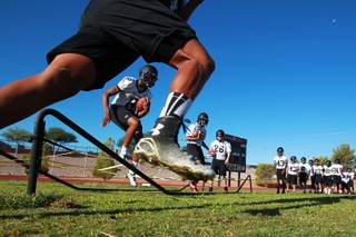 Palo Verde football players run a drill during their first official practice day Thursday, Aug. 14, 2014.