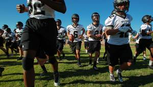 Palo Verde football players head for a water break during their first official practice day Thursday, Aug. 14, 2014.