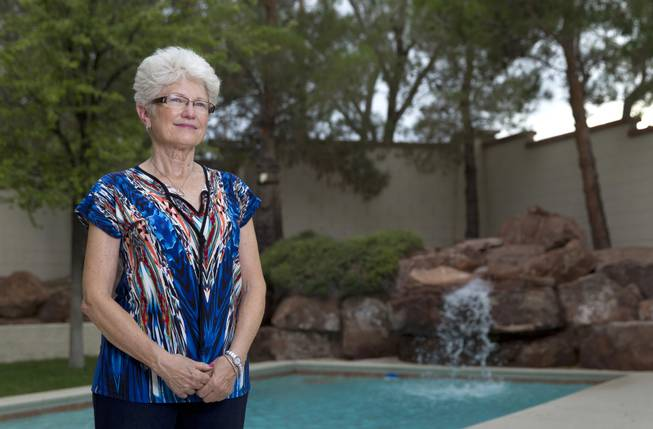 "Nancy Nelson, 70, poses at her home in Summerlin on Tuesday, Aug. 12, 2014. After being diagnosed with early-onset Alzheimer's disease last year, Nelson began waking up at 3 a.m. and would write poetry, she said. Her book of poetry titled ""Blue. River. Apple."" was recently published."