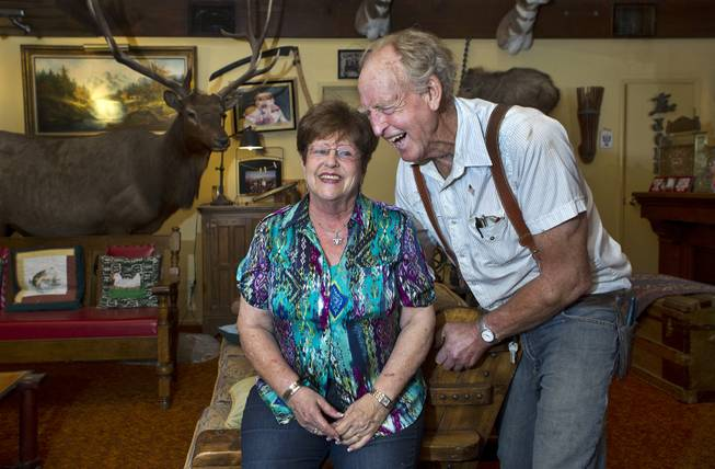 Bob Combs of R.C. Farms Inc. laughs with his wife, Janet, in their converted barn on Wednesday, Aug. 13, 2014.